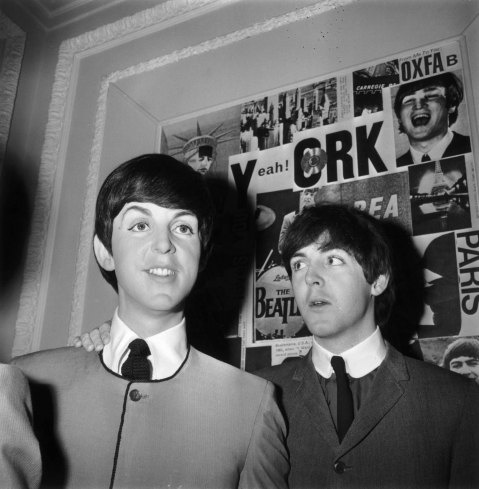 Paul McCartney at Madame Tussaud's waxworks with his newly unveiled effigy in London, England, April 29, 1964. Fashions by Yves St. Laurent. Photograher: Ron Case—Keystone/Getty Images