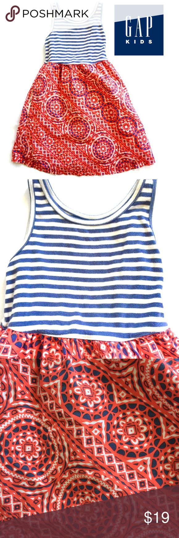 Gap Kids Vintage Style Patriotic Dress in S This Authentic Gap Kids Vintage Style Patriotic Dress in Girls Size Small (6-7) is adorable and faded everywhere.  This dress is straight up vintage and looks great with a denim jacket.  Cotton spandex tank and 100% cotton skirt.  There is a small Pilling on the tank which adds to the vintage appeal.  your daughter will jam out this Fourth of July with a 1776 look! GAP Dresses Casual