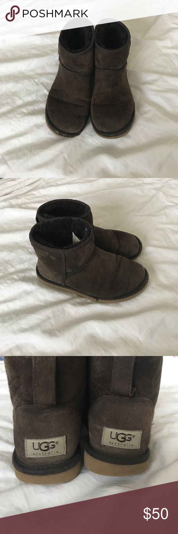 Chocolate brown UGGs mini boots Super cute, previously loved chocolate brown UGGs. Some signs of wear on the toes as seen in the pictures. Still a lot of life left in these. Open to all reasonable offers. UGG Shoes