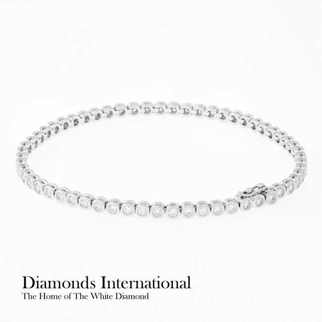 18ct white gold Diamond set bracelet - 59 x Round Brilliant Cut Diamonds = 1.55ct rub over set. Product Reference G2710. #diamondsinternational #whitegold #white #gold #bracelet #diamonds #bangle #roundbrilliantcut #gift #birthday #anniversary #girlfriend #wife #love #wedding #accessory