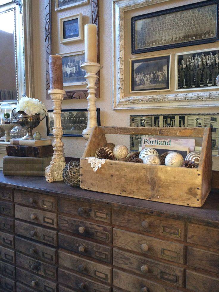 Old tool box, etc. Love the large frames around the smaller groupings! And the cabinet!
