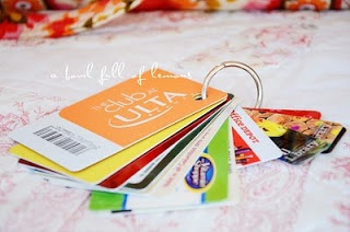 Grouped all discount cards on a ring  *make sure not to punch through a magnetic strip or number