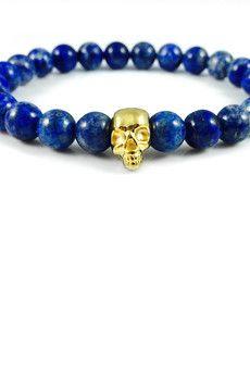 Dizarro to męska biżuteria najwyższej jakości produkowana z kamieni półszlachetnych, srebra, złota oraz kryształów Swarovski™.  Bransoletka wykonana z kamieni lapis lazuli oraz czaszki pokrytej 23-karatowym, złotem. Szczegóły:- czaszka pokryta 23-karatowym, włoskim złotem- bransoletka wkładana na elastycznej gumce- średnica kulek: 8 mm- bransoletka zapakowana w eleganckie, czarne pudełko