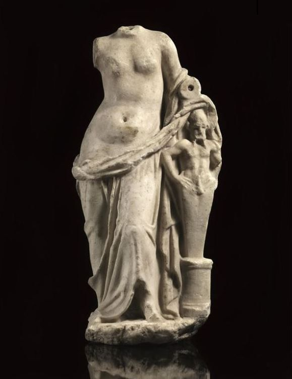 Roman art, Roman sculptures, Roman marble Aphrodite statue with Priapus, Hellenistic period, 1st century B.C.-1st century A.D.  Roman art, Roman sculptures, Roman marble Aphrodite statue with Priapus, Aphrodite is draped and leans on ithypallic herm on a column, 42 cm high. Private collection