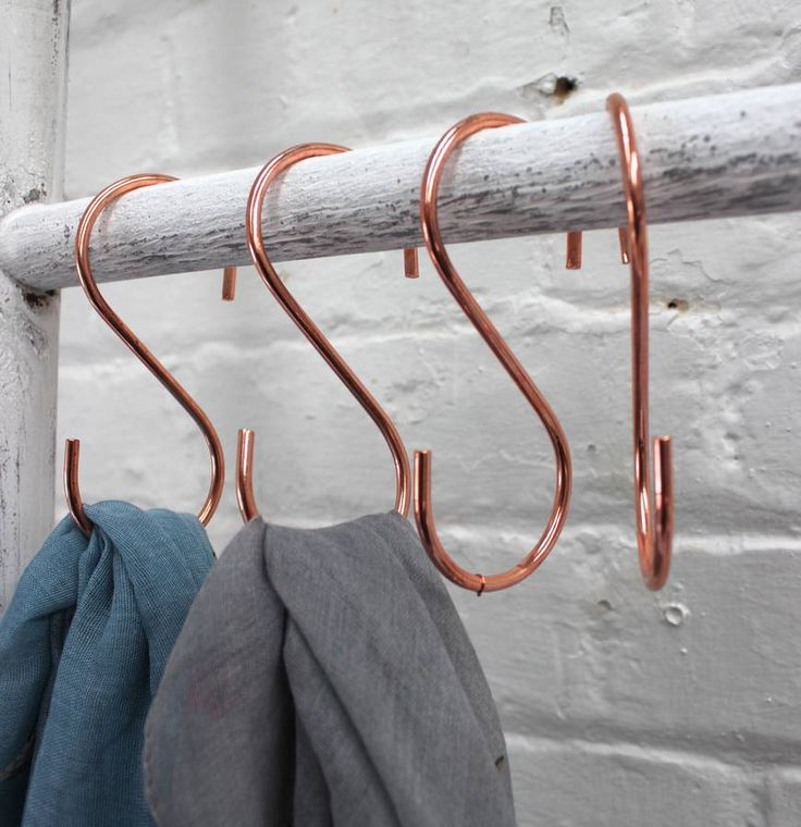 A set of four copper hooks.These 's' shaped copper plated hooks are really funky and practical too. They can be hung over a piece of copper piping in the kitchen to make a great display and storage for utensils and mugs.