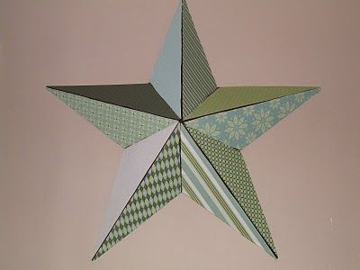 Tin star covered in scrapbook paper. You could use a cardboard star or gift wrap, whatever you have on hand :)