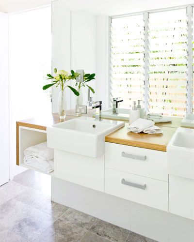 Louvre window and simple white cabinetry
