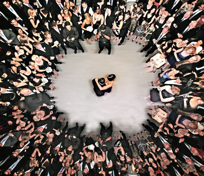 Why We Love It:We love how the couple is encircled by their loved ones in this...