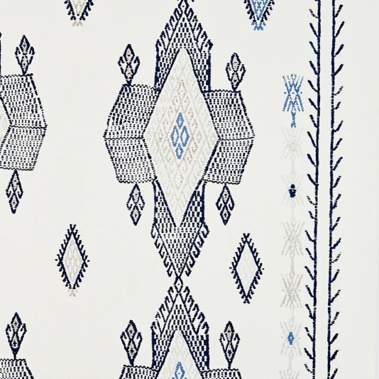 Travelling Light Wallpaper A stylish contemporary wallpaper designed by Kit Kemp, featuring a large scale kilim design in blue and neutral tones.
