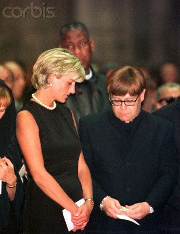 Diana and Elton John at Gianni Versace's funeral, July 22, 1997.  Princess Diana died a little over a month later in Paris on August 31, 1997.