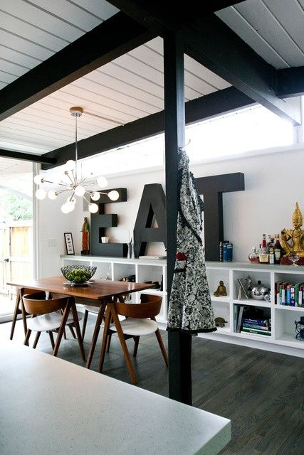 Love this dining room, the letters, light fixture and wood ceilings really make it.
