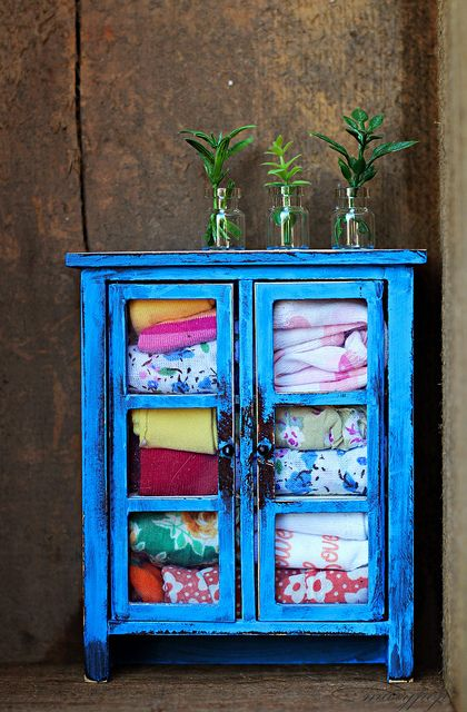 Great pop of color! Great storage for blankets, and quilts. Now to find a thrift store or garage sale cabinet similar to this one.