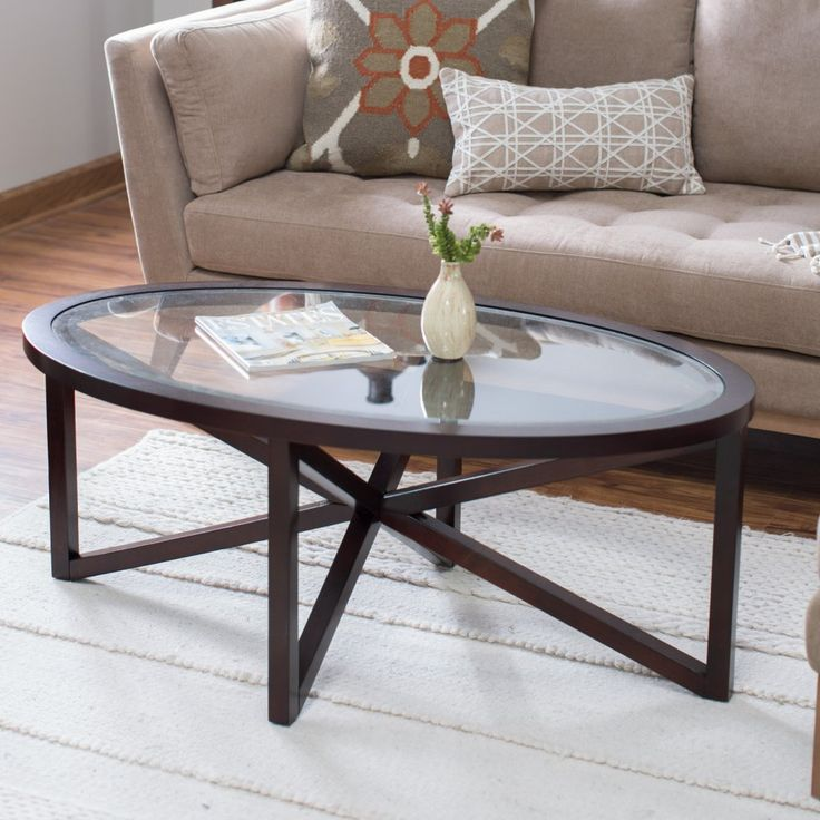 Webster Oval Coffee Table - Add visual intrigue to your living room decor plus have a handy place to set your coffee mug with the Webster Oval Coffee Table . Its interlocking X...