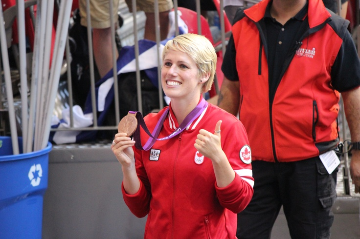 Sophie Schmidt of the Canadian Women's National Team showing off her London 2012 Olympic Bronze Medal at the Vancouver Whitecaps game on August 15, 2012.