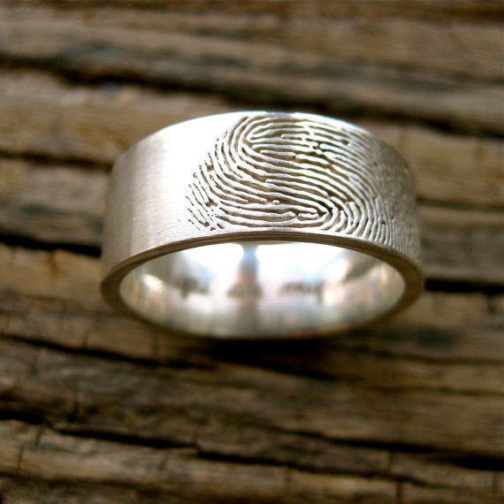 Custom Made Fingerprint Wedding Band for him. haha with these Bruce can be identified as yours by your finger print!