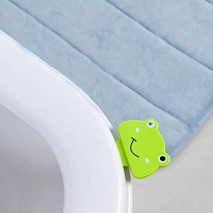 A frog-shaped toilet seat lifter. | 32 Insanely Awesome And Inexpensive Things You Need For Your Bathroom
