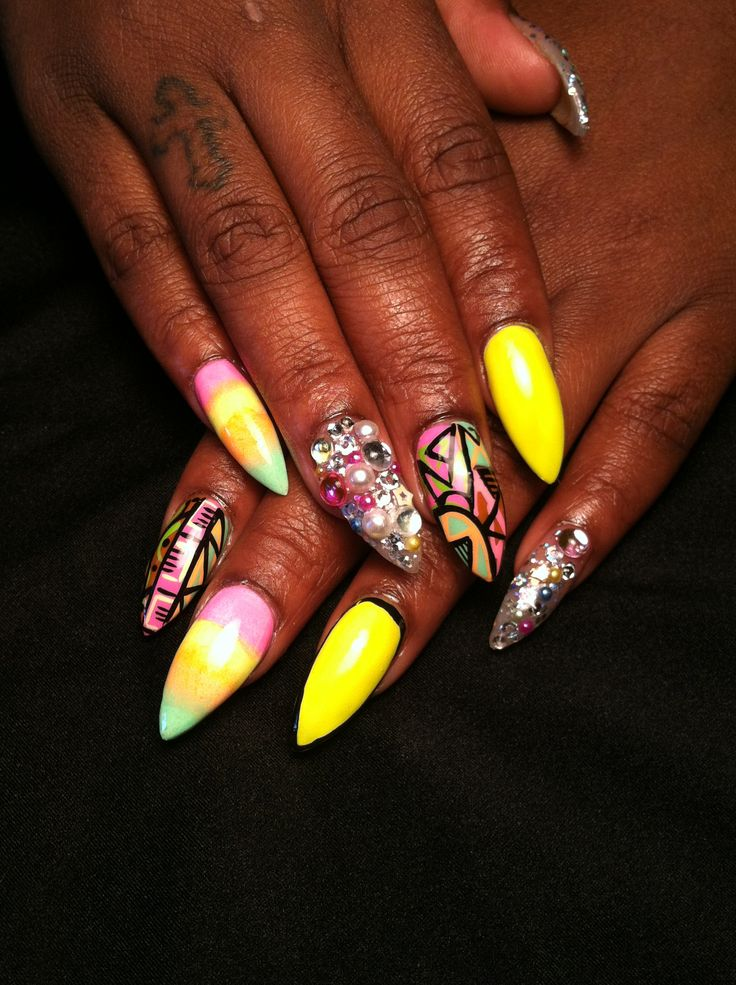 Electric yellow stiletto nails with jewels and added handpaint