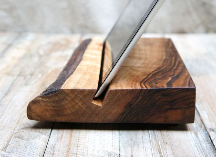 wood block iPad stand - SNAP!!!! Damn. Why can't I think of these things???? This would be GREAT in a really nice piece of cherry or heavy wood.
