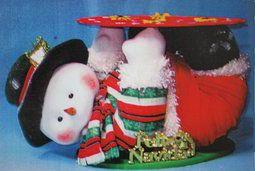 Muñeco de nieve panetonero echado