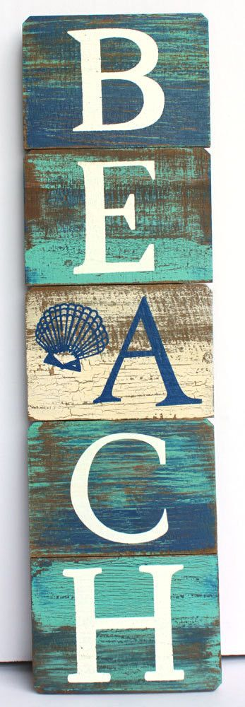 "Our vertical beach sign features peaceful coastal blue and green colors and is crafted from wood. Measures 23 1/2"" x 6 1/2"" when hanging - hinge folds to 14""h."