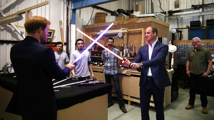 See more photos of Prince William and Prince Harry's lightsaber fight while they visted the 'Star Wars' set!