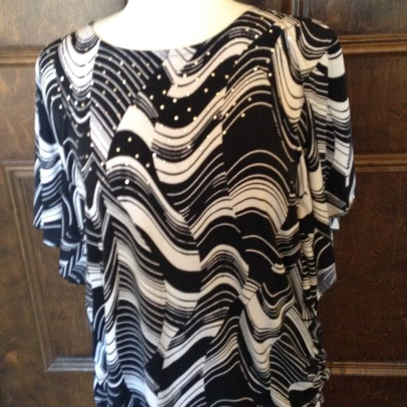JM Collection Black/White Batwing Pullover Top Pre-loved black and white tunic with short sleeves (bat wing), gathered at bottom on each side; stretchy material.  Excellent condition and very flattering.  Wash and wear.  No Trades JM Collection Tops Tunics