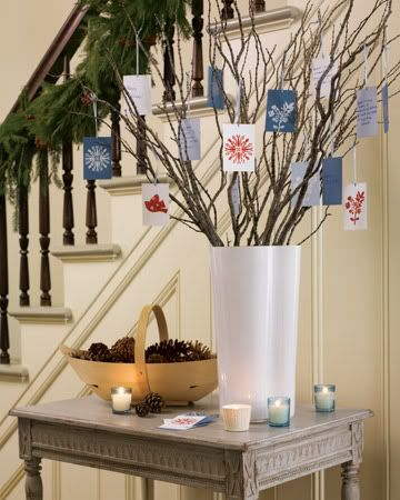 Under The Table and Dreaming: 50 Simple Holiday Decor Ideas - Christmas Card Display Tree...good idea for my branches in dining room...