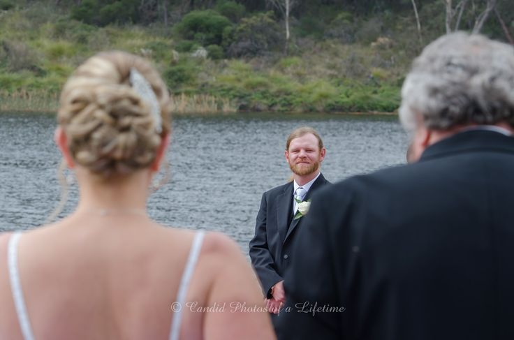 Wedding photographer, Candid Photos of a Lifetime  The groom having a 1st look of his gorgeous new bride