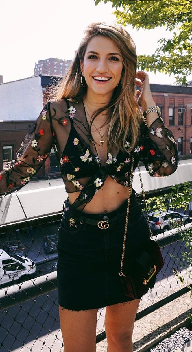#fall #outfits women's black, white, and red floral long-sleeved crop top with black denim skirt outfit