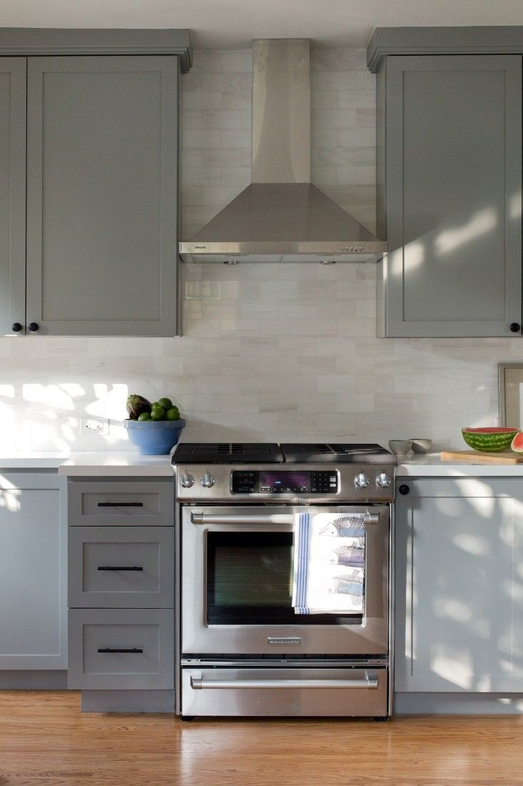 The cabinets are painted Chelsea Gray from Benjamin Moore. Design by Project M+ as seen on Remodelista