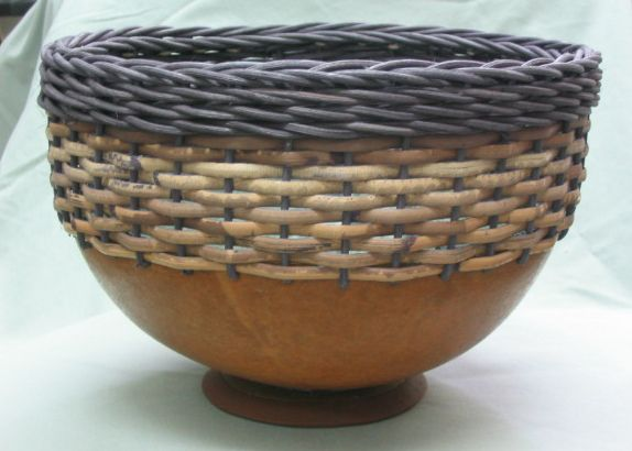 Large gourd bowl using round reed & dyed caning materials.