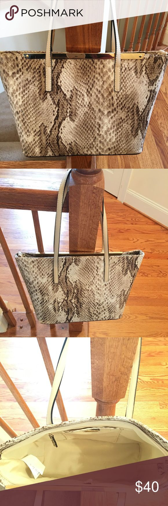 Aldo Handbag Barely used (about 3xs) Aldo snake skin purse. In good shape, brown and cream bag. Has a gold plate on front that adds great detail. Aldo Bags