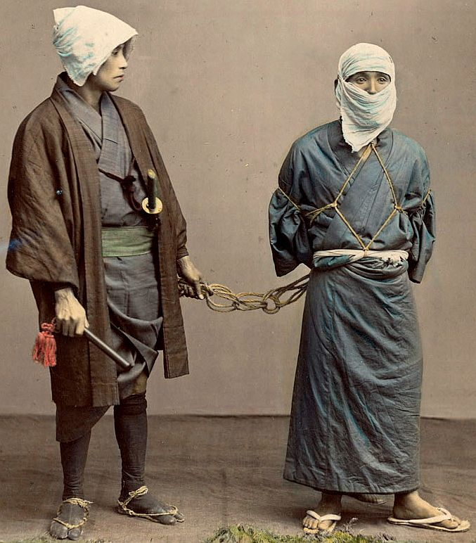 Samurai police official with bound prisoner.