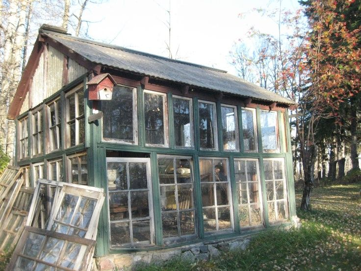 Beautiful Greenhouse Made Of Old Windows and Doors