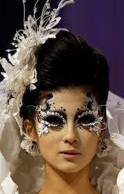 Masked ball or culture; all the masks  are painted on