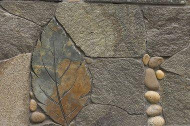 The Pecks - A stone carved into a leaf shape and set into a walkway