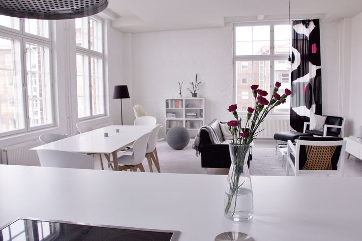 Living and dining room seen from the kitchen #livingroom #diningroom #flowers #bwhome #blackandwhite #BoConcept #Marimekko #loft #interior