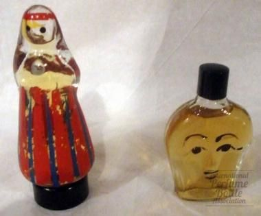 Young Woman & Mask  Specialty:Russian    Type:Figural shaped perfumes    Designer/Maker:Possibly by New Dawn factory, Moscow, USSR    Markings:Woman in babushka; Lady's face    Date or Era:Soviet era 1922-1989    Dimensions:3 3/4 in; 2 3/4 in