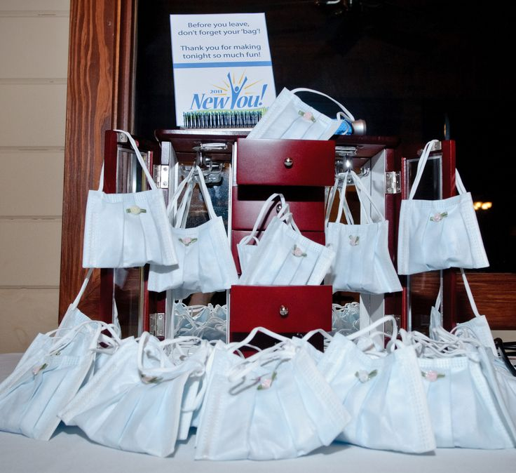 """Dental Party Ideas:  Centerpiece created for Clove Dental Makeover Reveal Party!  """"Purses"""" were created out of dental masks and were hung off of a jewelry armoire."""