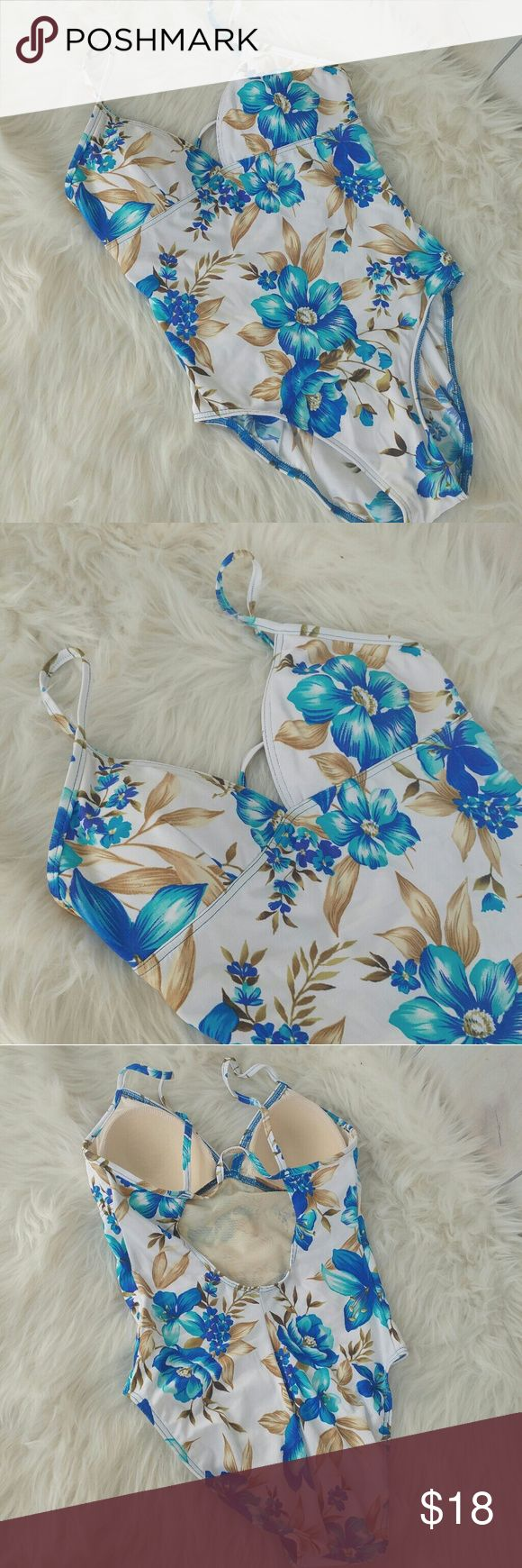 """Body I.D floral one piece swimsuit Excellent condition swimsuit by Body I.D Size 12  White with a blue floral print Light pads on bust no underwire   Pit to pit 15.5"""" Length 27"""" Body I.D. Swim One Pieces"""