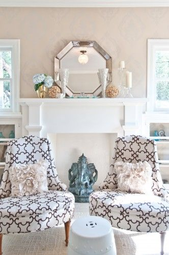 I love the pattern on the chairs, the white ceramic barrel could be a cute side table for your eclectic living room (I saw some cheap colorful ones we could spray for cheap @ graden ridge). Plus, Shannon likes it too