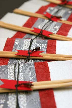 Picture of Japanese wedding invitations. Very creative design with chopsticks.