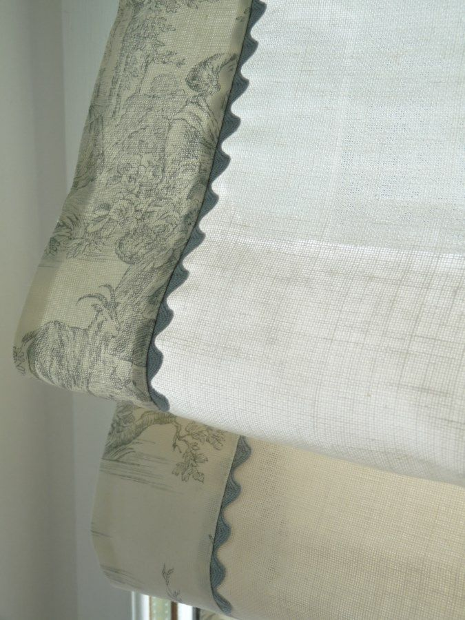 Interesting idea for trimming a Roman blind with ric rac and contrast edge.