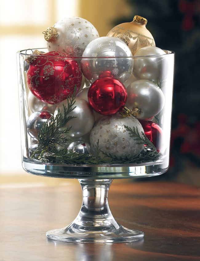 Bring the tree to the table without getting pine needles everywhere. Place a few small clipping from your Christmas tree at the bottom of our Trifle Bowl and fill with round ordimants.