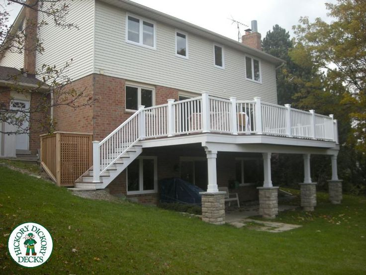 This is a one of a kind project. 500 sqft of Fiberon Ipe decking with a beautifull floor boarder. The white Geodeck composite rail is complimented by extensive white vinyl cladding on the substructure. Lots of attention to detail on this project. The stone columns give this deck a grand feel and pave the way for future landscaping.