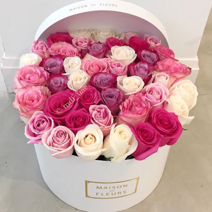 A beautiful arrangement of roses in varying shades of pink and white ~♡~