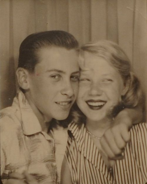 Teenagers in a photo booth, 1950s.