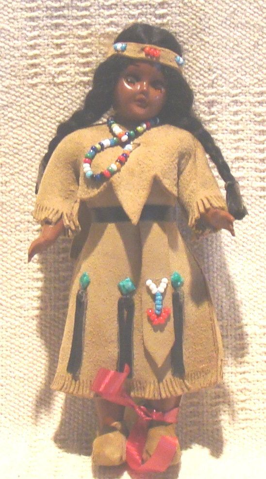 I had a doll just like this one, minus the red ribbon anklet.