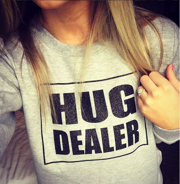 This sweatshirt for a mom who gives warm hugs… and has an edgy sense of humor.   17 Funny Shirts Every Mom Needs In Their Life