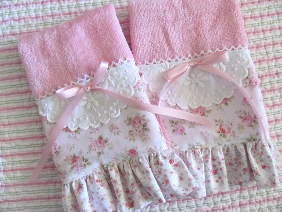 Welcome and thank you so much for stopping by today! For your consideration is a pair of darling pink 100% cotton fingertip/guest towels for your shabby bath or powder room. Or perhaps youd like to use them as one-of-a-kind tea towels! Center stage is are all-over plump pink rosebuds from the Mary Rose fabric collection. I have placed a vintage embroidered doily at the center of each towel. Peeking out across the top is a sweet embroidered lace edging. The 2.5 inch ruffle was made wi...